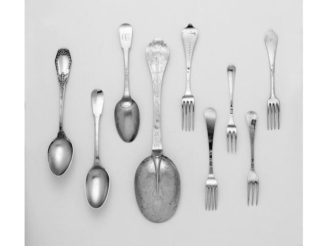 A collection of five reproduction silver caddy spoons