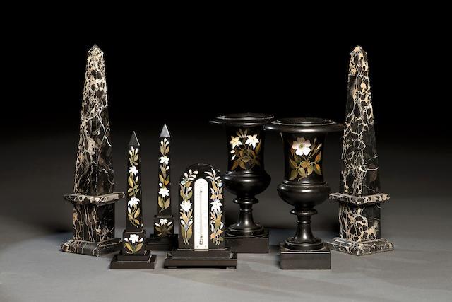 A pair of portor marble garniture obelisks