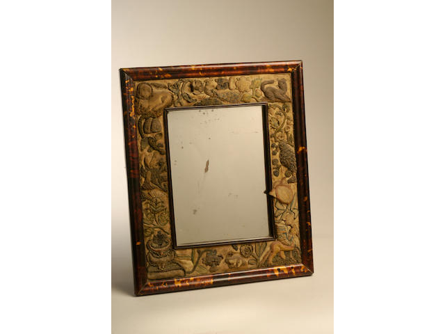 A 17th Century 'stump' work mirror frame,