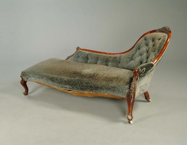 A Victorian walnut framed chaise longue