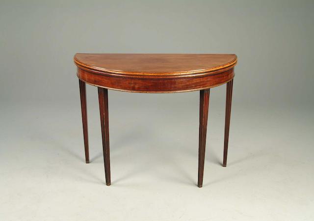 A George III mahogany demi lune card table