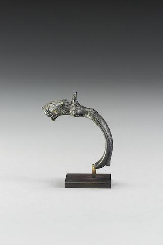A Roman bronze handle with lion head