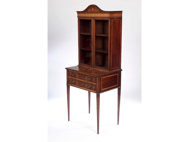 An Edwardian mahogany and marquetry inlaid cabinet on stand,in the manner of Edwards & Roberts,