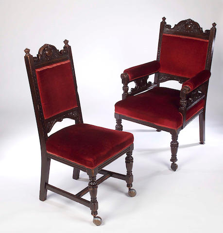 A set of twelve Victorian oak and upholstered dining chairs,