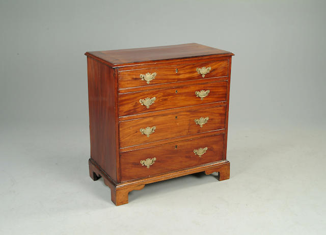 A George III mahogany and crossbanded chest