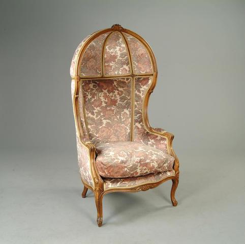 An early 20th century beechwood porters chair