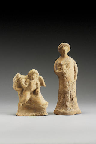 A Hollow terracotta Eros on dolphin and large hollow terracotta female (2)