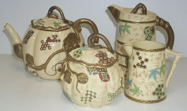 A Royal Worcester earthenware teapot and sugar bowl, and a similar water jug and cover, and milk jug, circa 1880-82,