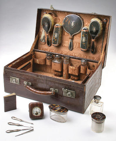 A comprehensive tortoiseshell and silver mounted travelling set, Birmingham 1917,