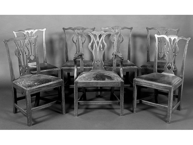 A set of seven George III Chippendale mahogany dining chairs,