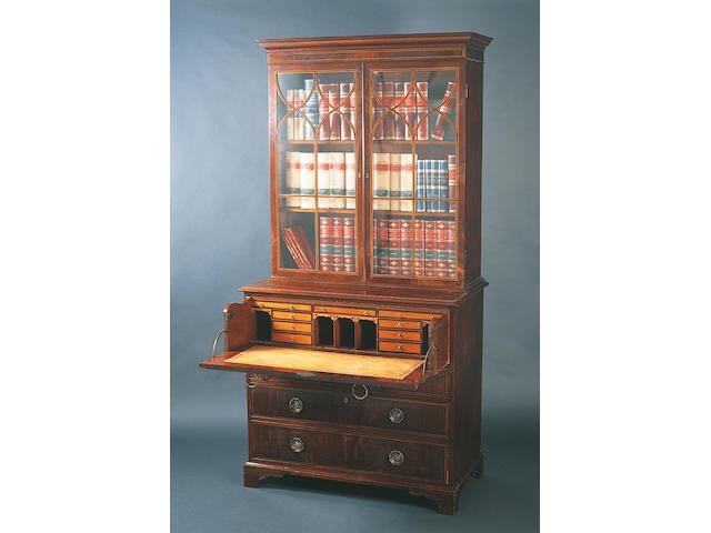 A George III figured mahogany and boxwood line inlaid secretaire bookcase,