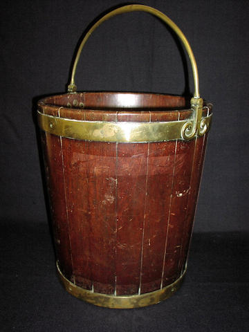 A George III mahogany and brass banded peat bucket