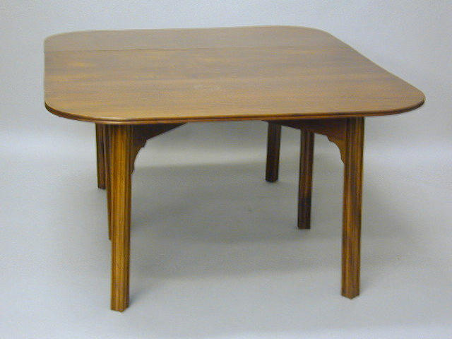 A George III style mahogany gateleg dining table,