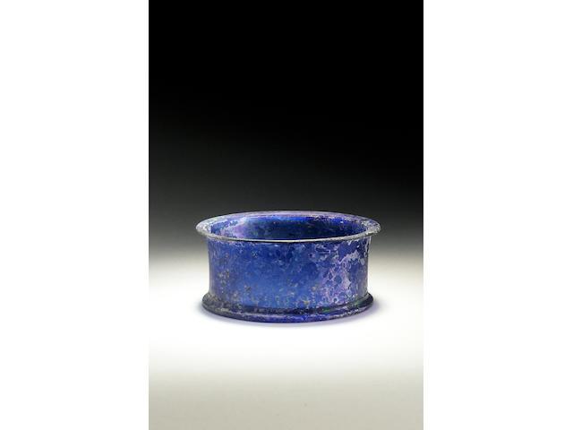 A Roman rare translucent cobalt blue cast glass lidless pyxis