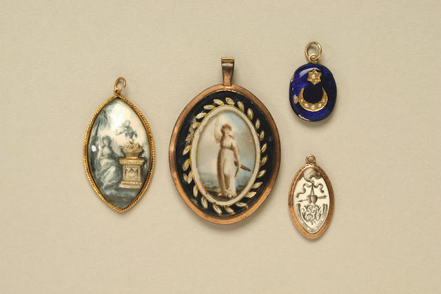 A late 18th century navette shaped gilt metal mourning pendant c. 1790,