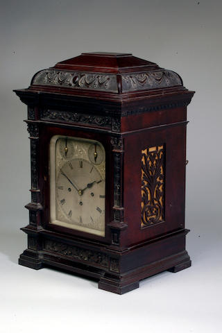 A Victorian carved mahogany quarter chiming bracket clock,