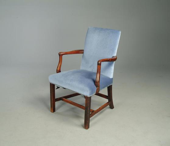 A George III mahogany library armchair,