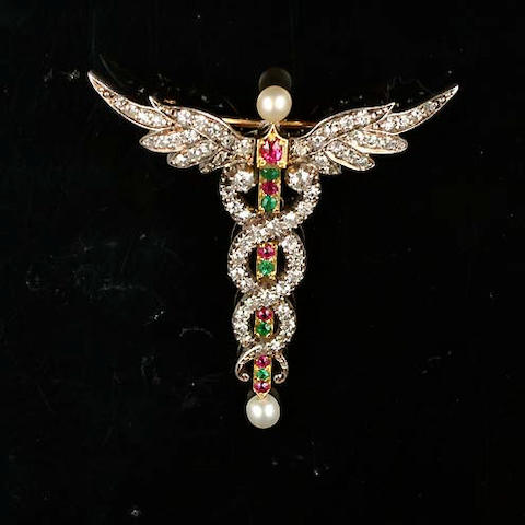 A late 19th century diamond, ruby and emerald caduceus brooch/pendant