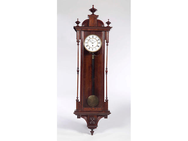 A late 19th century rosewood and simulated rosewood 'Vienna' wall clock,