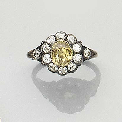A diamond and zircon cluster ring