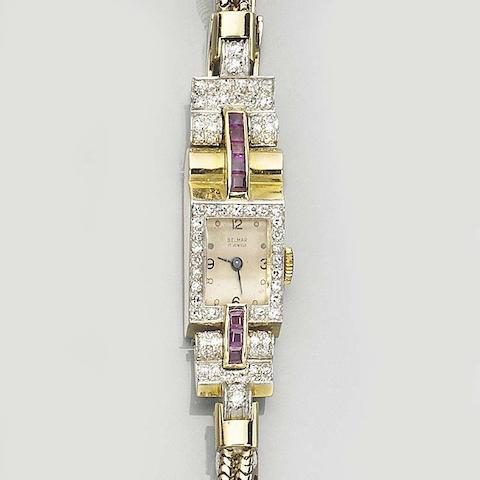 A ruby and diamond watch
