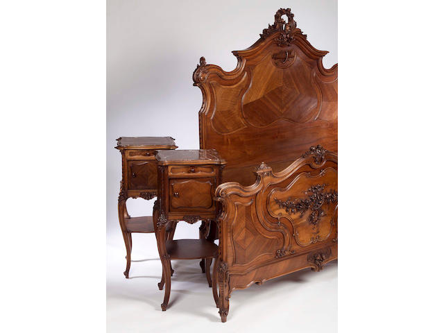 A late 19th century French carved walnut three piece bedroom suite,