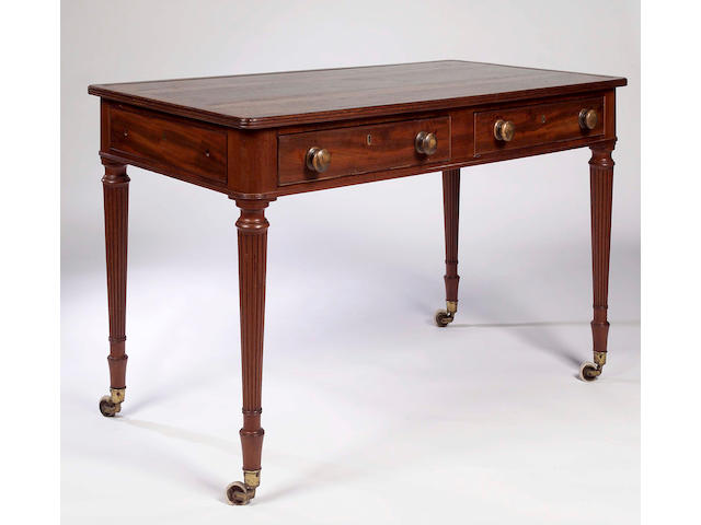 An early 19th century mahogany writing table,