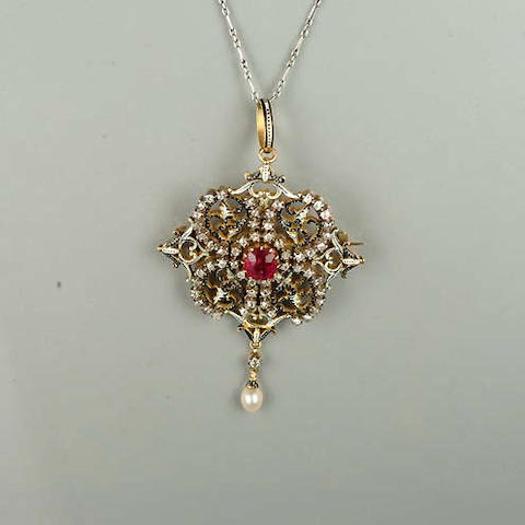 A late 19th century ruby, diamond and enamel pendant, by Carlo and Arthur Giuliano,