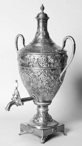 A George III samovar apparently unmarked to the body, cover with makers mark, C.W.? and lion passant, spout marked with lion passant, duty mark and makers mark S.D.,