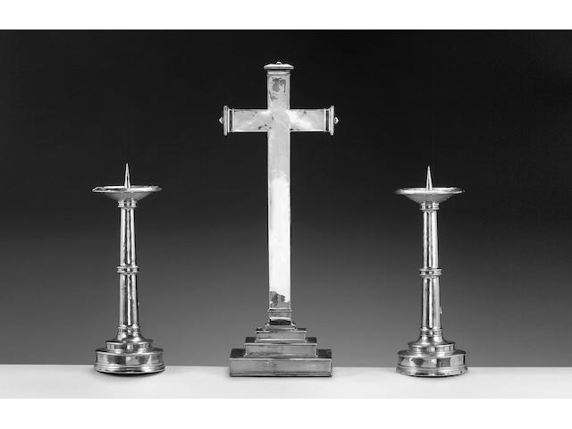 OMAR RAMSDEN : A pair of silver altar, pricket candlesticks, date letter rubbed, possibly 1925,