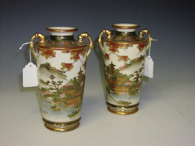 A pair of Satsuma twin handled vases,