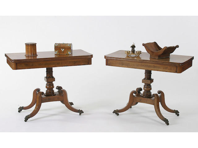 A pair of Regency mahogany and rosewood tea tables,