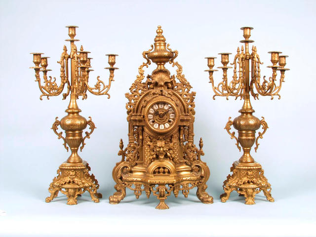 A French brass clock garniture