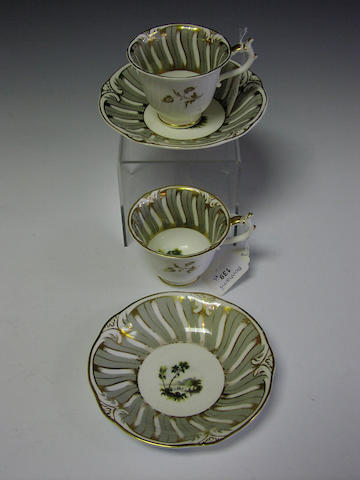 A pair of Rockingham tea cups and saucers,