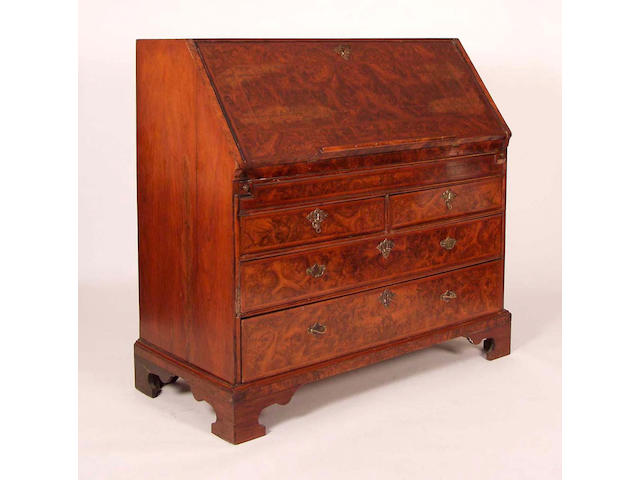 An early George III burr yew and featherbanded bureau,