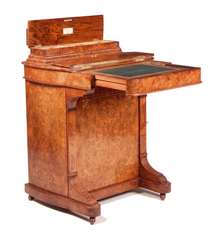 A mid Victorian walnut Davenport,by Rough and Son, London