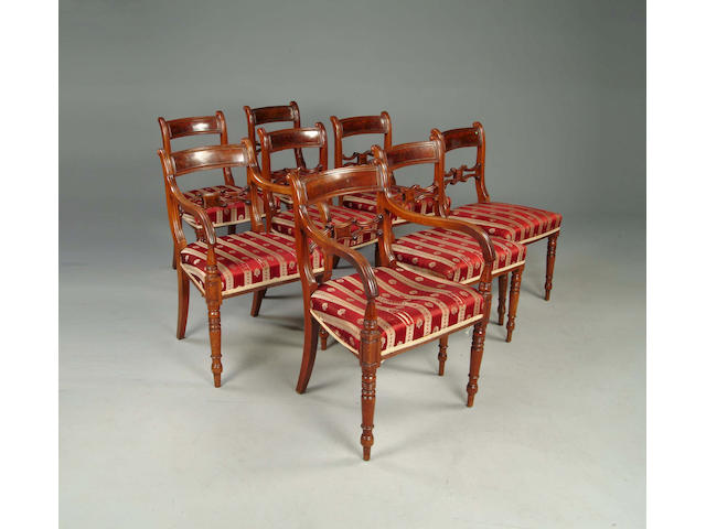 A set of eight Regency mahogany and brass strung dining chairs
