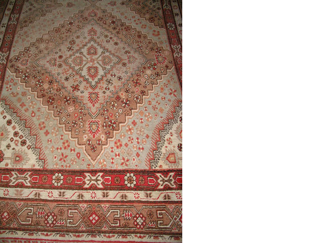 A Khotan long carpet East Turkestan, 393cm x 200cm