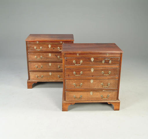 A pair of 20th century George III style mahogany chests of drawers