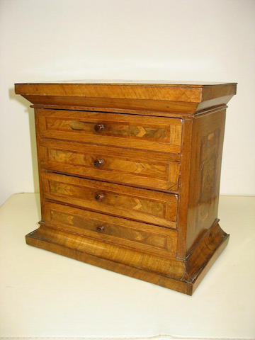 A 19th Century continental walnut, crossbanded and inlaid miniature chest