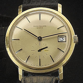 Patek Philippe. An 18ct gold automatic calendar wristwatch Ref:3445, Case No.332460, Movement No.123