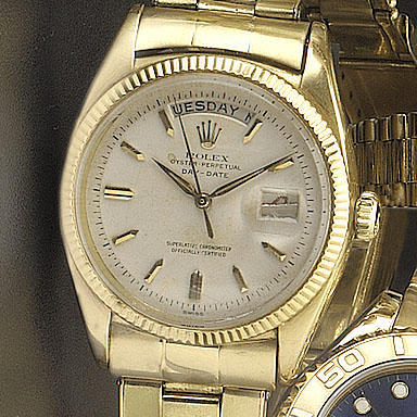 Rolex. An 18ct gold automatic centre seconds calendar bracelet watch with fitted box and papers Day-