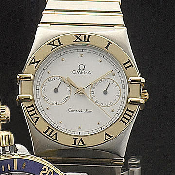 Omega.  A stainless steel and gilt quartz centre seconds calendar wristwatch with day and date indication, with original papers and spare linksConstellation, circa 1990 qtty