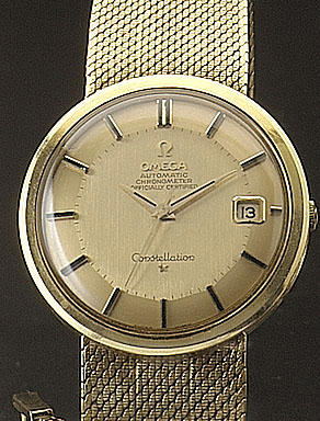 Omega.  An 18ct gold automatic centre seconds calendar watch  Constellation.  Hallmarked for 1964.