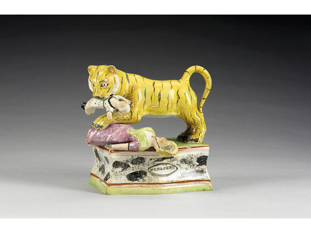 A titled pearlware group of a tiger attacking a woman and child, circa 1820-30,