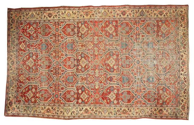 A Heriz carpet North West Persia, 18 ft 2 in x 11 ft 3 in (554 x 343 cm)