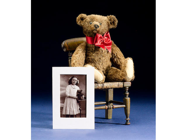 A Steiff Teddy bear, German circa 1909 together with letter of provenance and photograph of Teddy with his original owner.