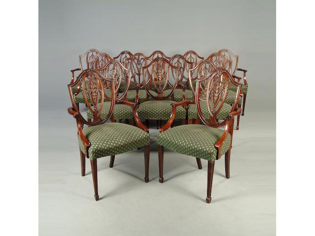 A set of thirteen mahogany shield back dining chairs