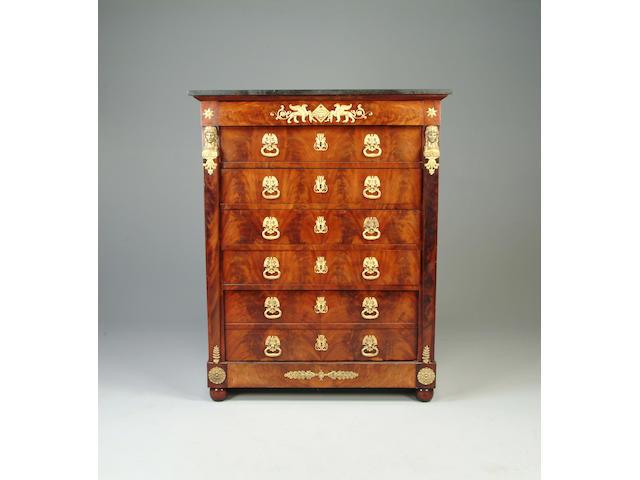 An Empire mahogany and gilt bronze mounted semanier