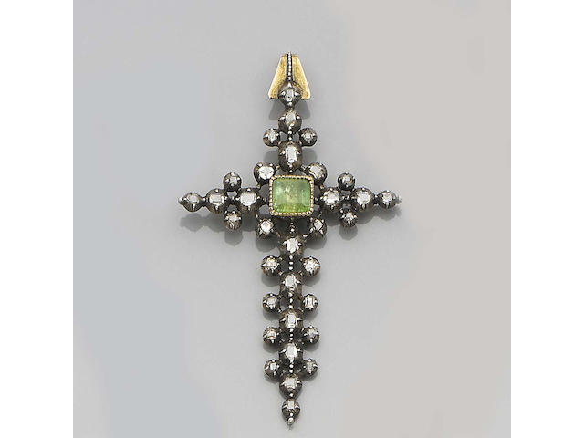 A diamond and emerald cross